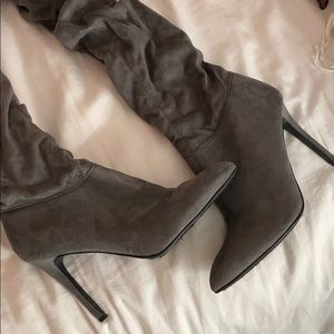 Thigh high gray heeled boots